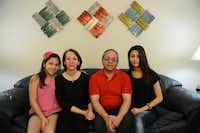 Sohrab Nobari, his wife Rozita and their two daughters, Rojin, 18, and Rojan, 10.(Rose Baca - Neighborsgo)