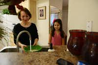 Rojan Nobari, 10, watches her mother Rozita cook dinner at the family's Plano apartment. The Nobari family found assistance through Plano nonprofit Family Promise while trying to settle in the U.S. after moving from Iran.Rose Baca - Neighborsgo