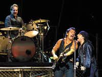 Bruce Springsteen (center), Steven Van Zandt (right) and drummer Max Weinberg (left) perform with the E Street Band at American Airlines Center in Dallas on November 3, 2002.