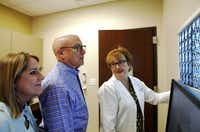 Michael McReynolds is participating in a clinical trial of a new vaccine that researchers hope will keep his brain tumor in check. Last week, he reviewed positive results of his most recent brain scan with  Dr. Karen Fink (right) at Baylor Sammons Cancer Center in Dallas and his wife, Ginger.