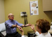 """McReynolds is examined by Fink at  Sammons Cancer Center. He said his decision to take part in the clinical trial was a """"no-brainer."""""""