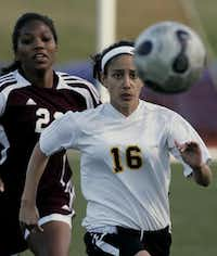 Diggs (23), left, played soccer for Rowlett High School, as well as club teams. She and Ashley Ramos (16) scrambled for a ball during a soccer match between Plano East High School and Rowlett High School on April 1, 2008, at Tom Kimbrough Stadium.(Ben Fredman - Submitted photo)