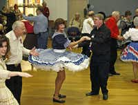 Nancy Barr, 55, takes a turn with Bill Knight, 57, of Dallas, at Octoberfeast, a reunion and food drive by dance groups in the North Texas Square and Round Dance Association held at the Farmers Branch Senior Center.