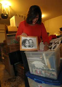 """It didn't feel like I had to completely give it away or sell it."" -- Jan Thompson, (shown here sifting through treasures boxed for her daughters), on parting with possessions."