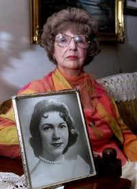 Herlinda de la Vina holds a portrait of her niece, Irene Garza, whose body was found in April 1960 in an irrigation ditch near the McAllen, Texas, church where she had gone several days before for confession. (2002 File Photo)