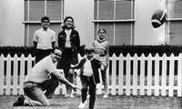 Lamar Hunt, who was owner of the Kansas City Chiefs at the time, served as the holder for his 5-year-old son Clark's kick in the family's backyard in Dallas. Behind them are son Lamar Jr. (left), wife Norma and daughter Sharron.