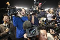At least 100 members of the media — almost half from Japan — came to Arlington to capture Yu Darvish's first day as a member of the Texas Rangers. The team doesn't expect any problems accommodating the increased media attention.