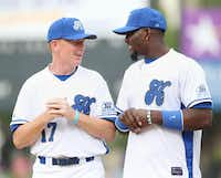 COWBOYS COACH  Jason Garrett (left) spoke to his star wide receiver, Dez Bryant, before the first pitch of Nowitzki's celebrity game.(Andy Jacobsohn - Staff Photographer)