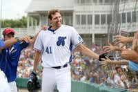 DIRK NOWITZKI , a star forward for the Mavericks, celebrated with fans after scoring a run during his Heroes Celebrity Baseball Game in June.(Photos by ANDY JACOBSOHN/DMN - Staff Photographer)