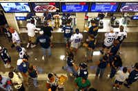 Cowboys fans mingled about one of the main concourse concession stands during a preseason game against the 49ers.