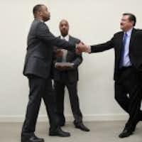 Congressional candidates in District 33, Marc Veasey, left, and Domingo Garcia, right, shake hands after they took part in a debate at the Dallas Regional Chamber offices at the Plaza of the Americas, on Friday, June 29, 2012. The event was moderated by Gromer Jeffers, Dallas Morning News reporter, center. (Michael Ainsworth/ The Dallas Morning News)
