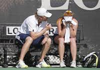 Highland Park's Chandler Carter (right) gets a pep talk from assistant coach Tylir Jimenez during the girls singles final. Carter fell behind, 1-6, 1-5, before coming back to win the match.(Photo by THAO NGUYEN - DMN Special Contributor)