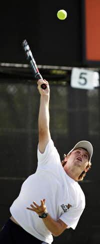 McCullough throws up a serve during his mixed-doubles final with Tedford.(Photo by THAO NGUYEN - DMN Special Contributor)