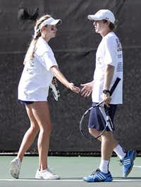 Mixed doubles partners Elizabeth Tedford and Mac McCullough of Highland Park cheer each other on during the final match, which they won, 6-0, 6-4.Photo by THAO NGUYEN - DMN Special Contributor