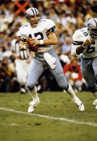 ORG XMIT: *S0420866287* Jan 21, 1979; Miami, FL, USA, FILE PHOTO;  Dallas Cowboys quarterback (12) Roger Staubach in action against the Pittsburgh Steelers during Super Bowl XIII at the Orange Bowl. The Steelers defeated the Cowboys 35-31. Mandatory Credit: Photo By Malcolm Emmons-US PRESSWIRE © Copyright Malcolm Emmons 02072010xSPORTS