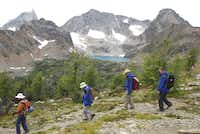 Hikers pass Cobalt Lake in Bugaboo Provincial Park. There are hikes to accommodate different skill and fitness levels.