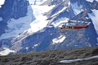 A Bell 212 helicopter flies hikers to a different destination each day in the remote Purcell Mountains of British Columiba.
