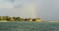 Somewhere over the South Pacific: a rainbow greets visitors arriving by boat to Tikehau in the Tuamotu Archipelago in French Polynesia.