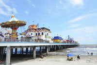 The Galveston Island Historic Pleasure Pier is very connected with the beach. Those who have a day pass to the pier can access the beach at anytime. Many rides fly over the gulf's waters for a special thrill.