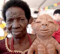 Reinata Sadimba of Mozmbique shows a clay figure she created.