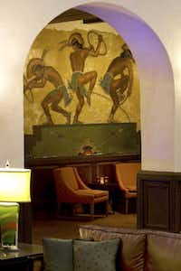 One of the original, restored murals is seen through an archway in the lobby of the Hotel Andaluz.