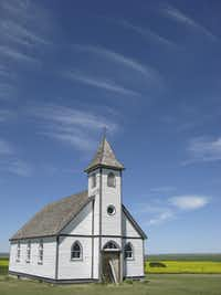 Standing atop a hill, Lutheran Peace Church, built in 1925 but now abandoned, is a lonely sentinel near Assiniboia in southern Saskatchewan.