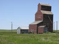 An aging grain elevator, one of a few hundred remaining from the thousands that once symbolized Saskatchewan's role as Canada's breadbasket, survives near Wood Mountain.