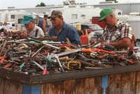 Men rummage through a huge container of used tools at Canton First Monday Trade Days. Women tend to prefer the pavilions; men like the unreserved area, which is more like a garage sale.Mary Ellen Botter