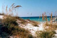 The white sand beaches of Destin, Fla. are a popular stop for Texas travelers. With current one-way deals on rental cars, you can fly down and take a couple of days to drive back home.