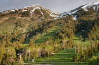 Sunrise lights the summer slopes at Jackson Hole Mountain Resort, Teton Village, Wyo.