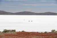 Visitors are quickly lost in the vastness of South Australia's Lake Gairdner whose flat, blindingly white surface makes them lose any sense of distance.