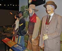 A trail boss, a buffalo soldier and other historical characters tell their stories at the push of a button at the Chisholm Trail Heritage Center in Duncan, Okla.