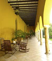 Rocking chairs on shady verandahs at Hacienda Misné.
