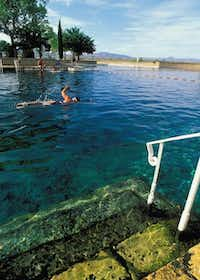 The clear, cool, spring-fed pool at Balmorhea State Park is populated with fish, turtles, and sometimes scuba divers. Texas Parks and Wildlife Department.( Texas Parks and Wildlife Department. )