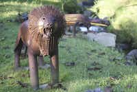 This lion, welded from recycled objects, appears in the mid-coast Maine sculpture garden of Nathan Nicholls.
