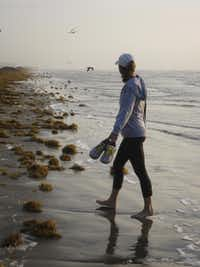 Early morning is the best time of day for a quiet walk in the sand at Port Aransas.