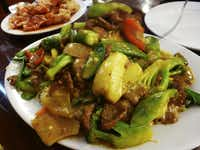 At the high end of the Chifa price scale is tallarin con carne al curry -- a beef and noodle dish with peas, okra, cucumber and pepper, with Chinese and Indian spices.