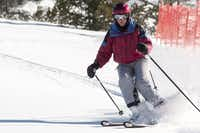 A CADS-clad skier descends a bump run on Aspen Mountain. At 50 degrees of knee flexion, CADS reduce effective body weight by 22 percent, a study concludes. Flex more and benefits increase.