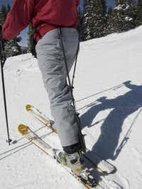 Through the use of a spring-loaded rod, CADS move upper body weight directly to the ski boots. The rods are easily removed for riding chairlifts.