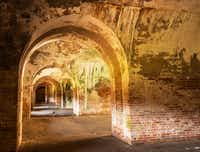 Arched doorways provide passageways through the casemates at Fort Morgan State Historic Site. Mold and seeping calcium deposits give the place a dank, cave-like smell.( Dan Leeth  -  Special Contributor )