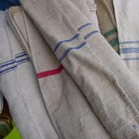 Foire de Chatou, Paris, France - Grain sacks Made of hemp and with a blue, red (or sometimes both) stripe down the middle, these circa 1920s sacks make for great table runners or pillows. Le prix: 25 to 75 euros per grain sack, depending on the quality.( Ellise Pierce  -  Special Contributor )