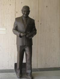 A life-size statue of President Lydon B. Johnson stands on the exterior of the LBJ Presidential Library in Austin, Texas.