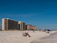 Guests sunbathe on the sand in Orange Beach, Alabama. In late spring and early fall, temperatures are pleasant and the beaches uncrowded.( Dan Leeth  -  Special Contributor )