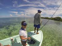 Lori Irwin and guide Lloyd Nuñez scan for bonefish, which are lightning fast and prized by anglers, on Glover's Reef.Brian Irwin  -  Special Contributor