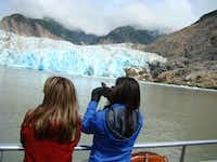 Oosterdam passengers on an excursion from Juneau get a close look at South Sawyer Glacier, the wall of ice at the end of Tracy Arm.