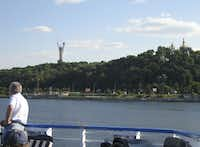 EUROPE: Dnieper River, at Kiev, Ukraine: Sailing out of Kiev, passengers line the rails to view the city's golden domed churches. The Dnieper is the third longest river in Europe, after the Volga and Danube.