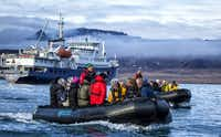While the small Plancius can get in close to the shore, passengers are ferried in inflatable Zodiac boats.Phil Marty