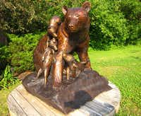 A family of bronze bears sculpted by Forest Hart in the sculpture garden at Northport Landing Gallery, a scenic stop for those biking or driving along Maine's Coastal Route 1.