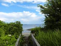 A boardwalk across from Point Lookout leads to a rocky scenic beach on Penobscot Bay in Maine.