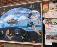 A bicycling-themed mural animates the outside wall of Alexia's Pizza in Belfast, Maine.